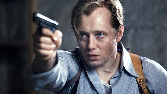 Der Widerstandskämpfer Max Manus (Aksel Hennie) leistet Widerstand bis zur letzten Kugel.