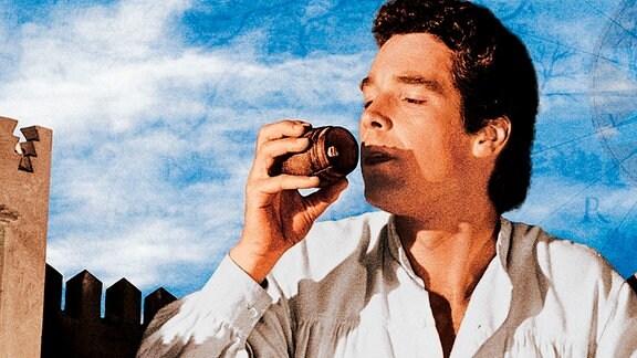 Gulliver trinkt auf der Insel Liliput- als Riese - aus einem winzig wirkenden Fass. Zwei Bewohner der Insel stehen vor ihm.