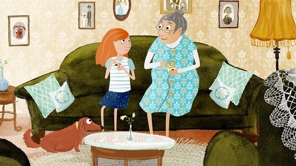 Molly und Rosa sitzen auf einem Sofa.