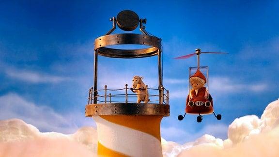Nepomuk auf einem Leuchtturm und der Sandmann in einem Hubschrauber