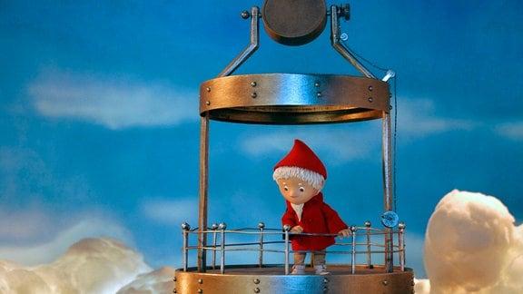 Der Sandmann auf einem Leuchtturm.