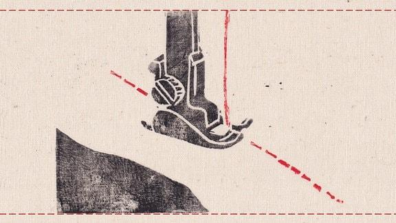 Die Nadel einer Nähmaschine.