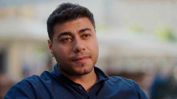 Bei Wandelbots arbeiten Menschen aus 12 Nationen. Auch der Programmierer Ahmet aus Ägypten.