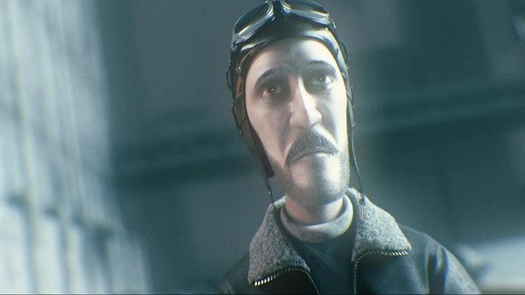 Mitten im Chaos des Krieges steht ein Mann mit Fliegermütze.