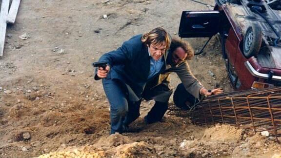 Der arbeitslose François Pignon (Pierre Richard, r.) nimmt bei einem Banküberfall den Ex-Bankräuber Lucas (Gérard Depardieu) als Geisel.