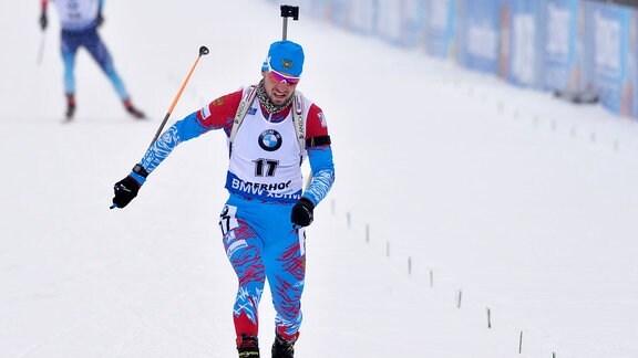 Sprint-Sieger Alexander Loginow (RUS) überquert die Ziellinie.