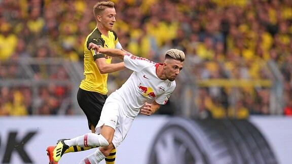 Marco Reus (Dortmund) im Zweikampf mit Kevin Kampl (RB Leipzig)