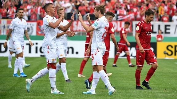 DFB-Pokal (1. Runde), VfB Germania Halberstadt - 1. FC Union Berlin, v. l. Grischa Prömel (1. FC Union Berlin), Christopher Lenz (1. FC Union Berlin), Jubel nach Tor zum 3:0