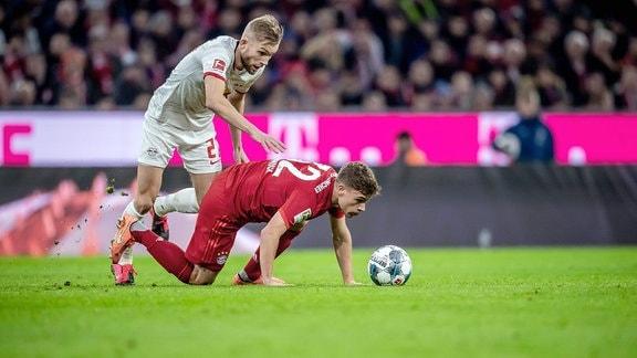 Münchens Joshua Kimmich gegen Leipzigs Konrad Laimer.