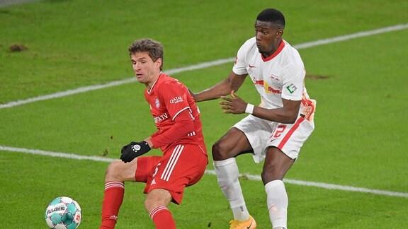 Thomas Müller Bayern München gegen Nordi Mukiele RB Leipzig