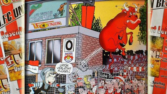 Collage aus dem offiziellen Programmheft von Union Berlin für das Spiel Union Berlin gegen RB Leipzig (18.08.2019). Im Hintergrund die Cover des Stadionheftes. Vorn ist ene Karikatur von Sam  zu sehen. Auf dieser tritt das Union-Maskottchen einen roten Bullen, in der Sprechblase ist Union verleiht Flügel zu lesen. An der Anzeigetafel ist ein entfremdetes Logo von RB Leipzig mit zwei Ratten, einem Ball und dem Schriftzug Rattenball Leipzig zu lesen.