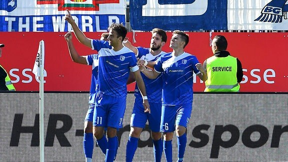 Christian Beck (1. FC Magdeburg 11) jubelt ueber sein Tor zum 1:0 mit Bjoern Rother (1. FC Magdeburg 6), Marcel Costly (1. FC Magdeburg 9), Romain Bregerie (1. FC Magdeburg 33)