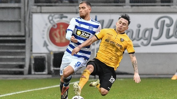im Zweikampf: Ahmet Engin ( 9, MSV Duisburg) und Baris Atik ( 28, Dynamo Dresden)