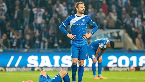1.FC Magdeburg - 1. FC Heidenheim emspor, v.l. Tobias Mueller (Magdeburg, 5), Jan Kirchhoff (Magdeburg, 4), Tarek Chahed (Magdeburg, 24) enttäuscht,