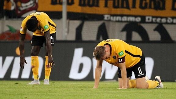 Moussa Kone und Marco Hartmann (Dresden) enttäuscht nach der 0:1 Niederlage