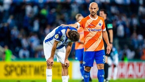 Christian Beck  11 1. FCM, Fabian Holland  32 SV Darmstadt 98 waehrend der 1. Runde des DFB Pokals 2020-2021 zwischen 1. FC Magdeburg und SV Darmstadt 98