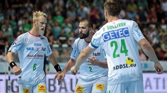 Jubel bei Matthias Musche , Zeljko Musa und Christian O Sullivan (alle SC Magdeburg)