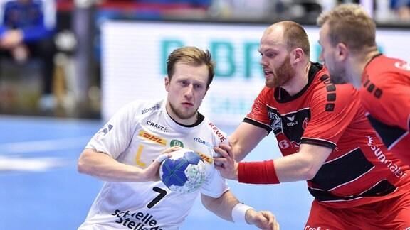 Luca Witzke (SC DHfK Leipzig) am Ball.