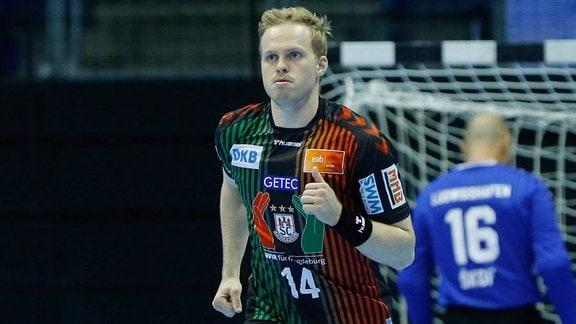 Omar Ingi Magnusson Magdeburg, jubelt über ein Tor.