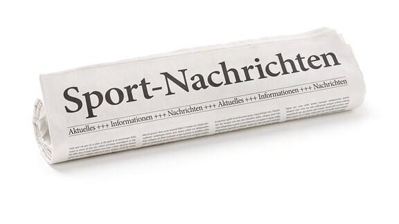 Zeitung mit der Aufschrift: Sport-Nachrichten