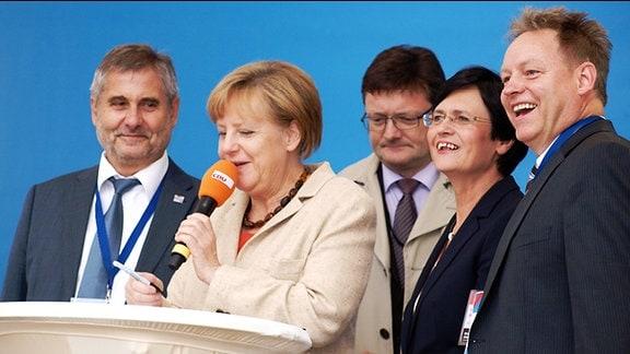 Bundeskanzlerin Angela Merkel am Mikrofon