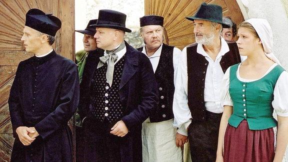 (v.li., vorne): Pfarrer (Richard Sammel), Amtmann ( Wolfgang Böck), Wirt (Reinhard Reiner), Vreni Miller (Franziska Weisz).