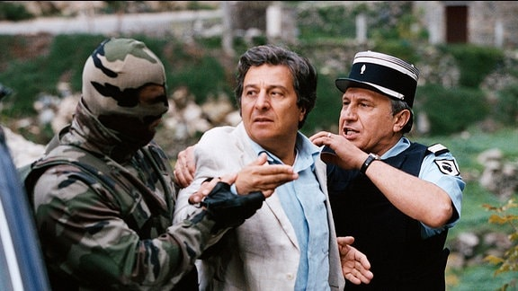 Privatdetektiv Remi (Christian Clavier, M.) wird festgenommen.