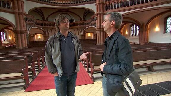 Frank Ebert (rechts) und Riccardo Barkawitz (links) in der Gethsemanekirche in Berlin
