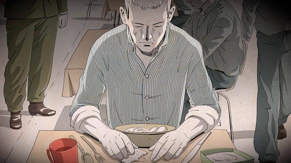 Ein Mann sitzt an einem Tisch und ist Brot.