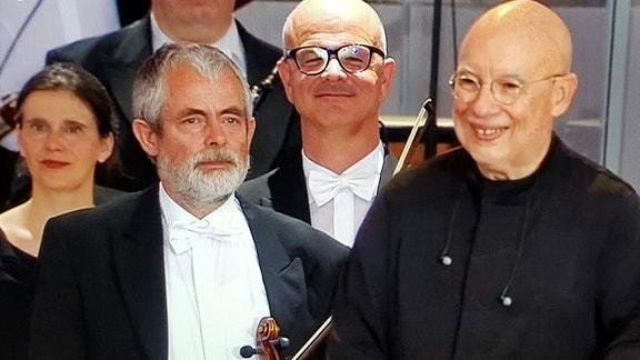 Wolfgang Max und Dirigent Dennis Russell Davies