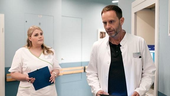 Chefarzt Dr. Kai Hoffmann (Julian Weigend) hat das Gefühl, die Patientin Vera Bader bald entlassen zu können. Schwester Miriam (Christina Petersen) bittet ihn, das mit Dr. Kaminski abzusprechen. Bader ist seine Patientin.