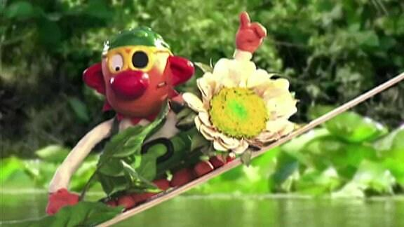 Pirat Rasmus Rotbart bringt zu Lawinas Geburtstag eine Blume.