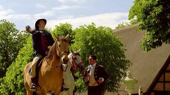 Meisterdieb Robert sitzt auf einem Pferd.