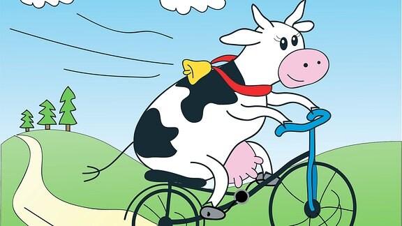 Eine Kuh auf dem Fahrrad.