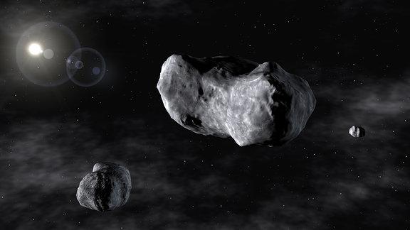 Künstlerische Darstellung des Asteroid 87-Sylvia und seiner Monde Romulus und Remus