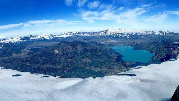 The 10-km wide caldera on Alaska's Unmak Island formed during the 43 BCE Okmok II eruption. This massive eruption caused among the most extreme Northern Hemisphere weather conditions of the past 2,500 years that coincided with the fall of the Roman Republic.