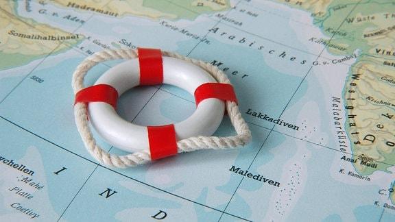 Rettungsring auf einer Landkarte mit den Malediven