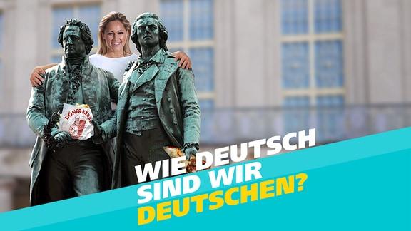 Eine blonde Frau (Helene Fischer) legt ihre Arme um die Bronzestatuen der Dichter Goethe und Schiller. Der Statue von Schiller wurde eine Tüte mit der Aufschrift Döner Kebap in die Hände gelegt.