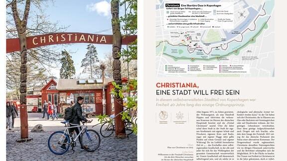 """Hinter einem Tor, gebildet aus zwei geschnitzten Holzpfählen und einem Brett mit der Aufschrift """"Christiania"""", sind bemalte kioskartige Holzhäuser zu sehen. Davor Fahrradfahrer und Tourist*innen."""