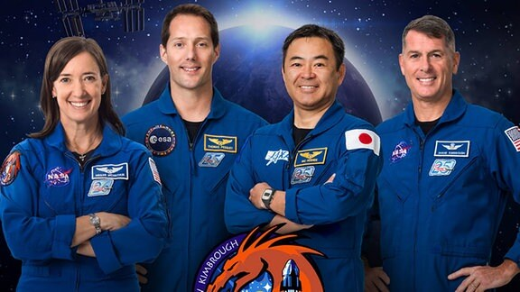 Von links nach rechts: NASA Astronaut Megan McArthur, ESA (European Space Agency) Astronaut Thomas Pesquet, JAXA (Japan Aerospace Exploration Agency) Astronaut Akihiko Hoshide und NASA Astronaut Shane Kimbrough
