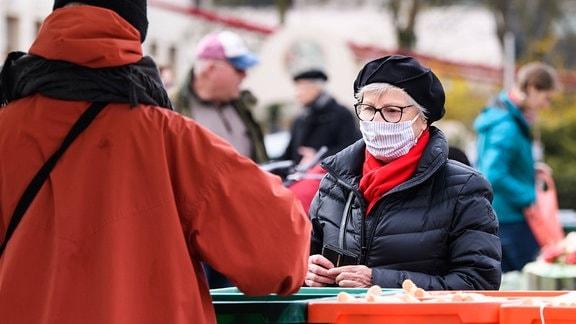 Corona Gesichtsmaske Ansteckung Markt Leipzig