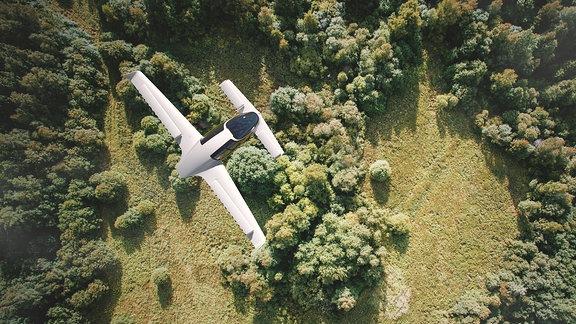 Animation eines futuristischen Fluggeräts mit vier Tragflächen im Flug von oben.