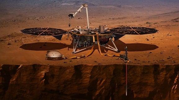 Diese künstlerische Dartsellung zeigt die InSight Mars-Mission der amerikanischen Raumfahrtbehörde NASA. Das Landemodul ist auf dem Mars gelandet und mit ihm der Mars-Maulwurf vom DLR (Deutsche Zentrum für Luft- und Raumfahrt).