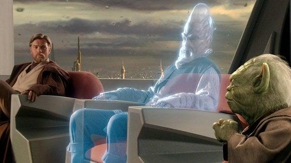 Filmszene aus Star Wars, ein Jedi bei einer Versammlung erscheint als Hologramm