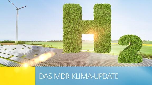 """Das Symbol """"H2"""" in Form einer grünen Hecke vor einem Windrad und einer Photovoltaikanlage."""