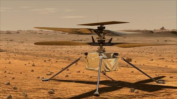 Eine silberner Kleinhelikopter steht auf der Marsoberfläche.