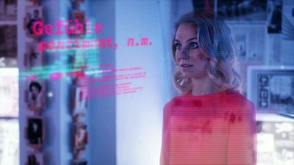 Eine Frau steht im Raum, neben ihr der Schriftzug Gefühle.