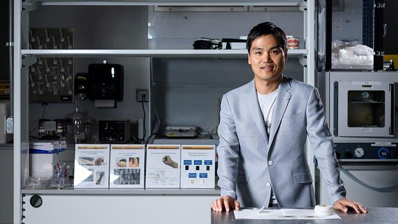 Woon-Hong Yeo, an assistant professor in the Woodruff School of Mechanical Engineering and Institute for Electronics and Nanotechnology at the Georgia Institute of Technology, is shown with the sodium sensor in his laboratory.
