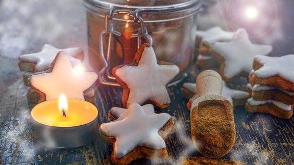 Zimtsterne, Teelicht und Zimtpulver