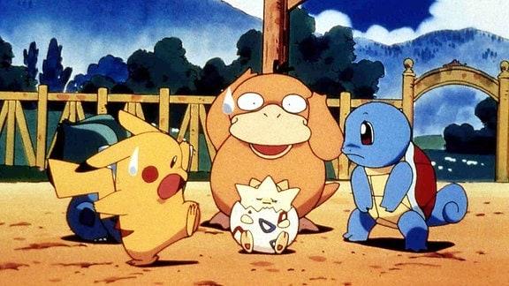 Ein buntes Pokemon bild mit drei verschiedenen Figuren.